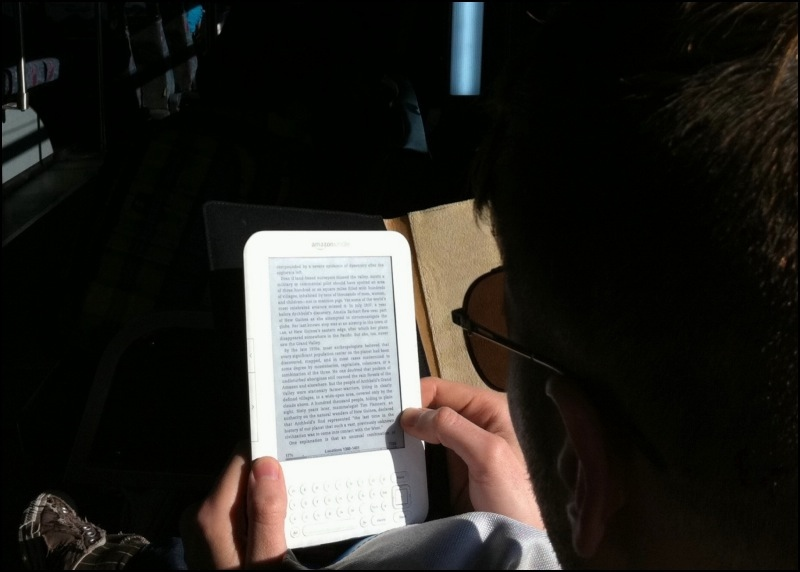 Reading Kindle On The Bus