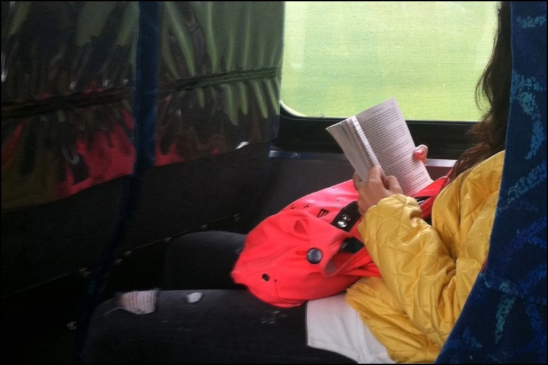 Reading Paperback On The Bus
